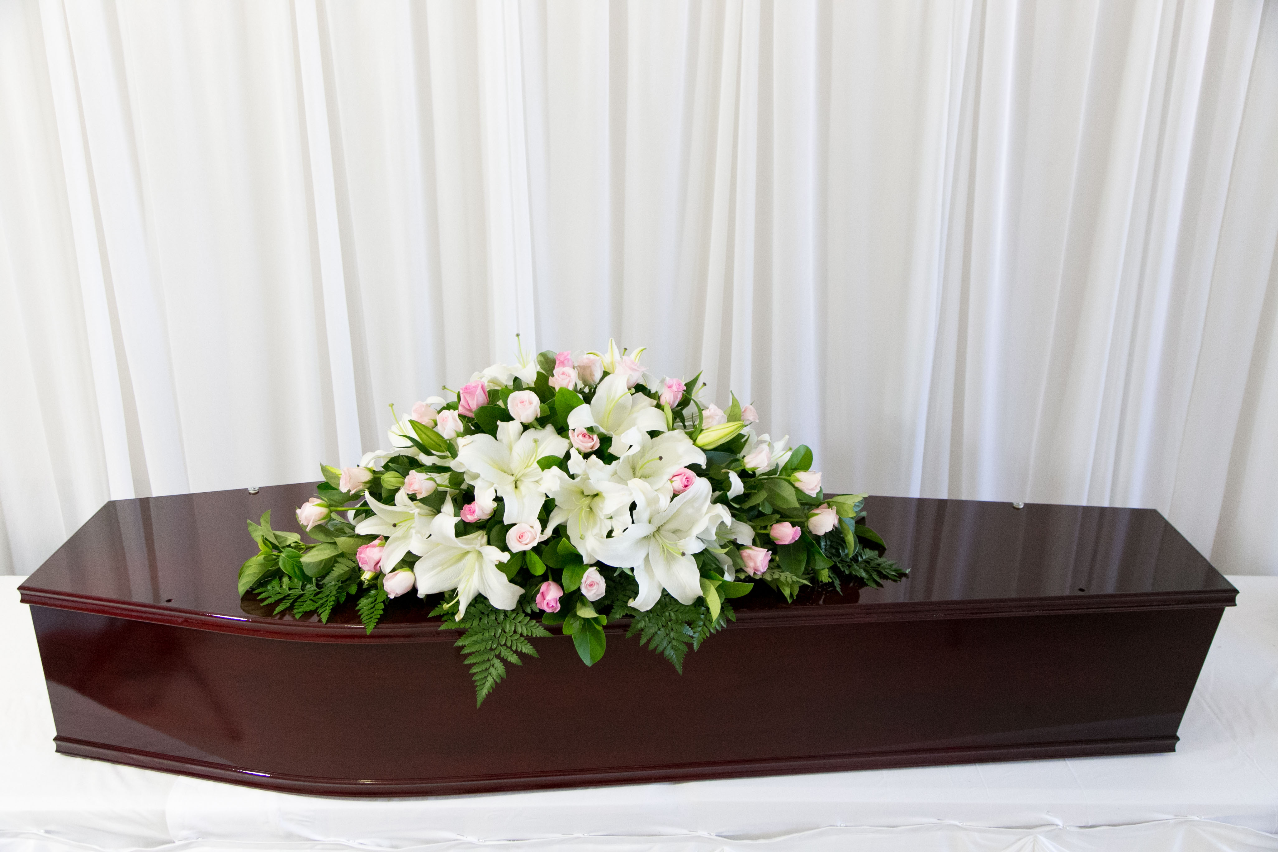 CASKET SPRAY LILIES AND ROSES
